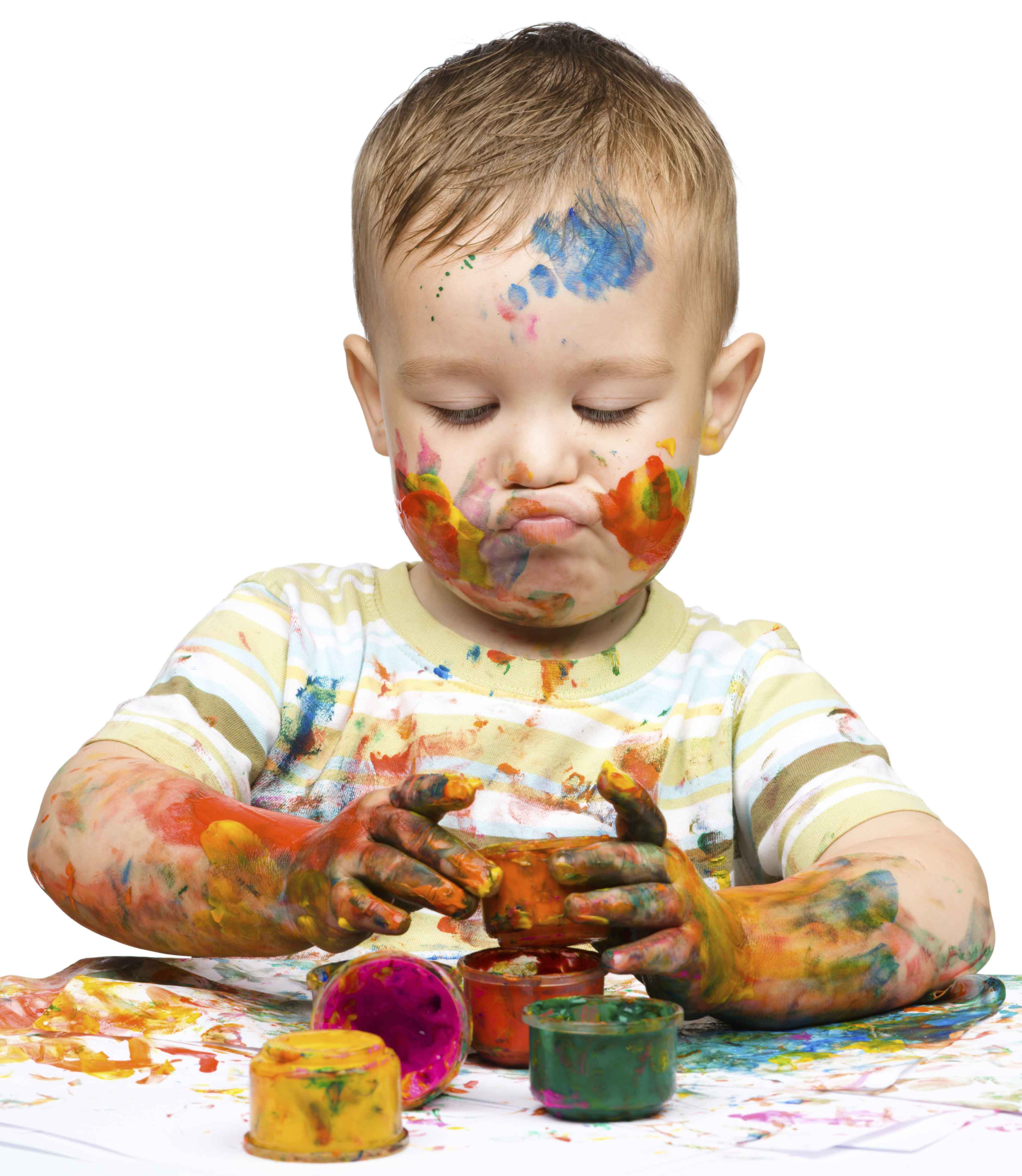 Sensory processing; boy playing with paints